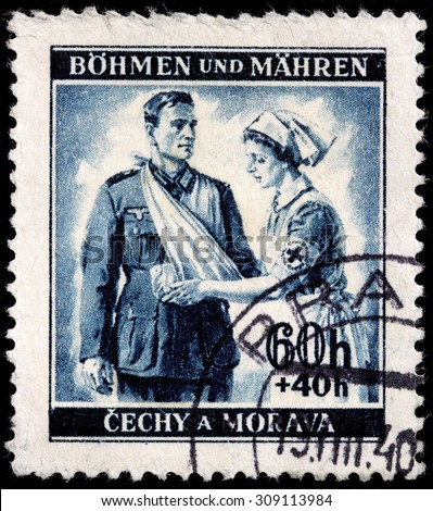 BOHEMIA AND MORAVIA - AUGUST 10, 2015: A stamp printed by BOHEMIA AND MORAVIA shows Red Cross nurse and wounded German soldier, circa June, 1940. - stock photo