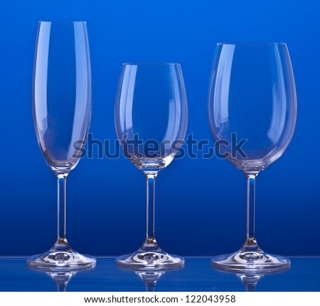 Bohemian crystal glasses. Aligned and backlit - stock photo