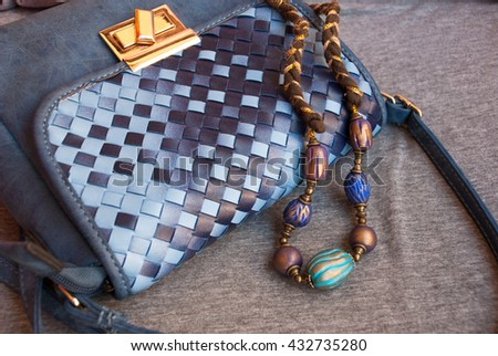Bohemian jewelry necklace indian with small woman bag. Handmade beads inoriental style of polymer clay. - stock photo