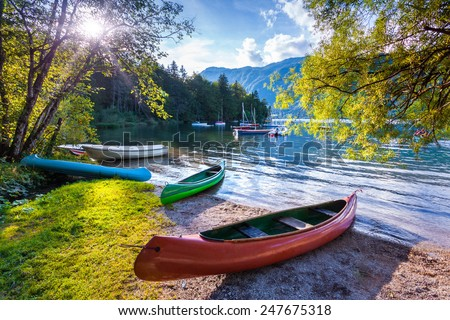Bohinj Lake with boats, Triglav National Park, Julian Alps, Slovenia. - stock photo