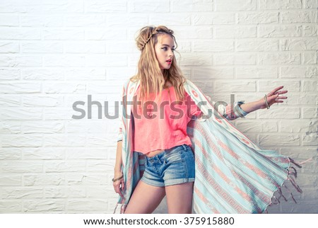 Boho Fashion Girl at White Brick Wall Background - stock photo