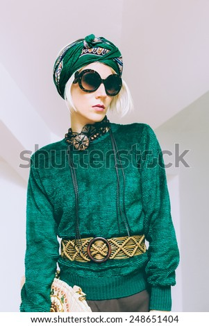 Boho style glamorous lady. Spring fashion accessories. Sunglasses, scarf, bag - stock photo