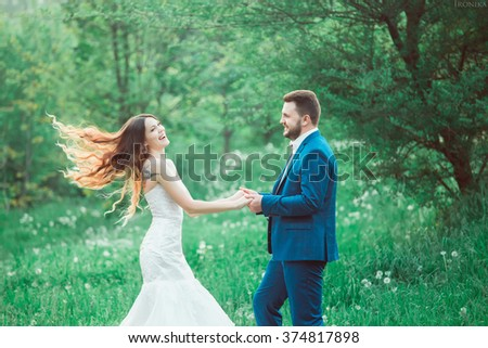 boho style wedding, vintage wedding, bride and groom, sincere feelings, a holiday for two, a wedding in retro style, fashionable toning, creative color - stock photo