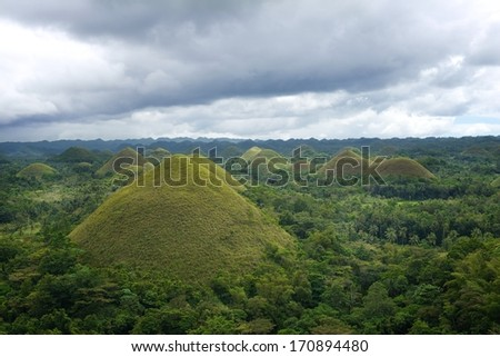Bohol, Philippines. Chocolate Hills with deep dark cloudy sky, Philippines.View of Chocolate Hills. Panoramic view of the Chocolate Hills in Philippines.They are mention in provincial flag.  - stock photo