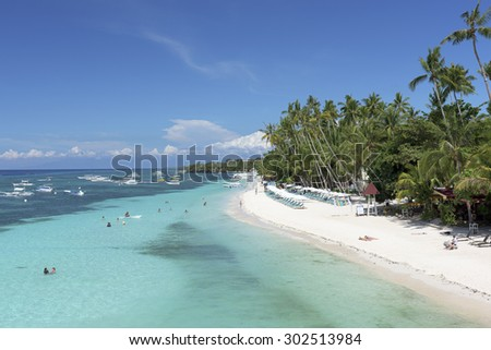 Bohol, Philippines - Jun 1, 2015: Alona Beach in Panglao Island, Bohol. Aloha beach is the most visitedtourist spot  in Bohol.  - stock photo