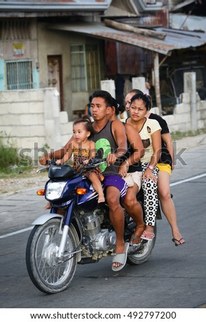 BOHOL PHILIPPINES May 16 2015 - A family of five riding a motorcycle. In 2015 the World Health Organisation reported that more than fifty percent of road deaths in the Philippines are motorcyclists