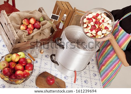 boil apples, make apple juice itself, on a table, many different apple varieties - stock photo