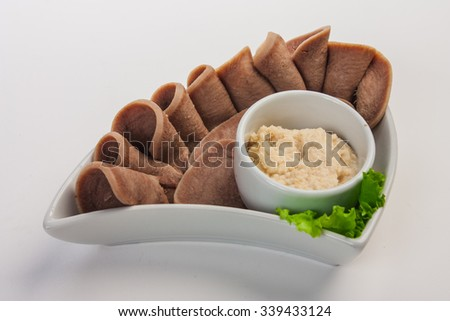 Boiled beef tongue with horseradish sauce and salad - stock photo