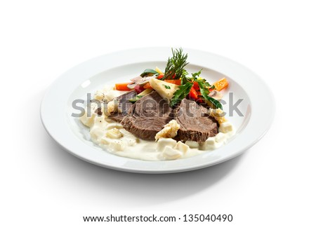 Boiled Beef with Apple Sauce, Vegetables and Horseradish - stock photo