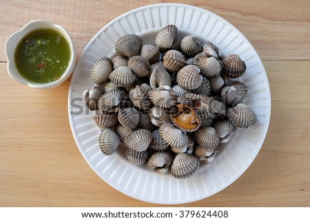 Boiled cockle with seafood sauce - stock photo