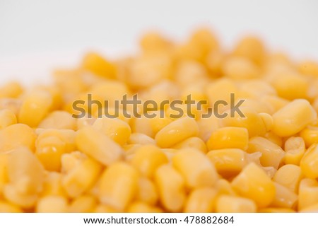 boiled corn close-up on a light background