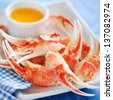 Boiled crab claws with orange sauce, selective focus - stock photo