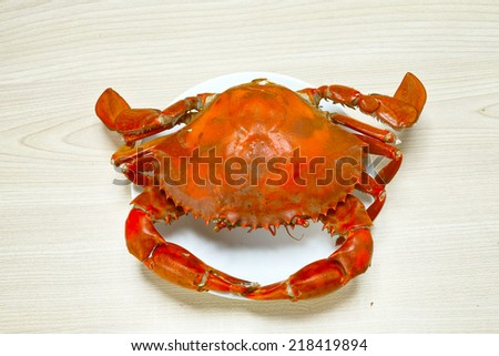 boiled crabs on a dish at the table - stock photo