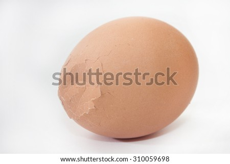 Boiled cracked egg on the white background. - stock photo