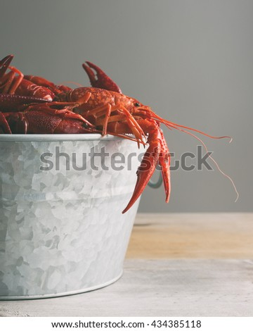 Boiled crawfish in a galvanized steel bucket.  - stock photo