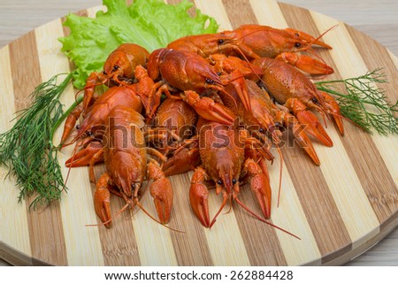Boiled crayfish in the bowl with dill - stock photo