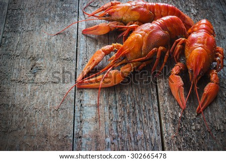Boiled crayfish on a wooden old  background - stock photo