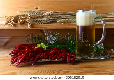 boiled crayfish with beer on wooden table - stock photo
