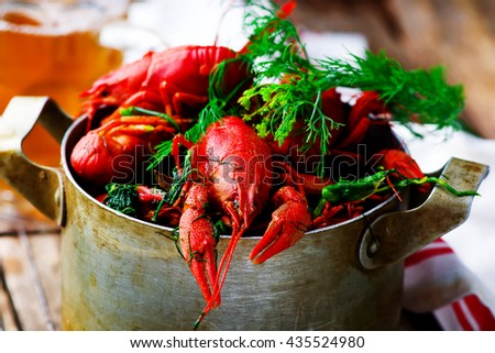 boiled crayfish with dill in a vintage metal pan. style rustic. selective focus - stock photo