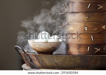 Boiled eggs breakfast in the street, China - stock photo