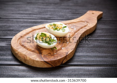 Boiled eggs on a cutting board. - stock photo