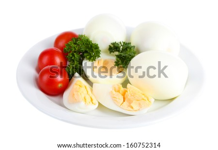 Boiled eggs on plate isolated on white