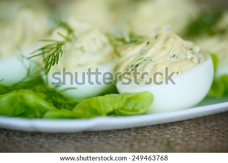 boiled eggs stuffed stuffed with greens on a plate
