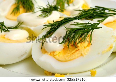 Boiled eggs with mayonnaise and dill, close-up. - stock photo