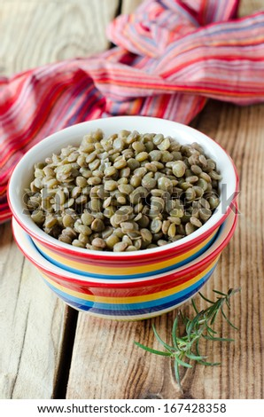 Boiled green lentils in a bowl - stock photo