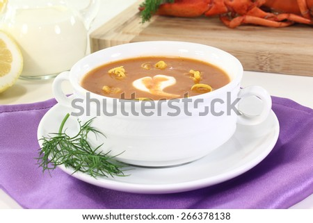 boiled lobster soup with lemon, dill and cream dollop