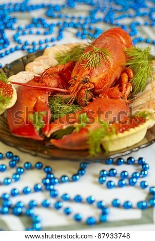 Boiled lobster with red caviar and herbs - stock photo