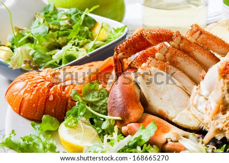 boiled lobster with salad and wine cup