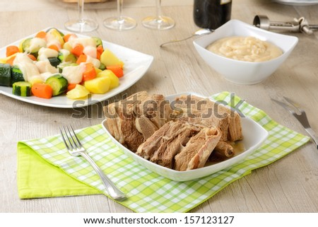 Boiled meat with sauces