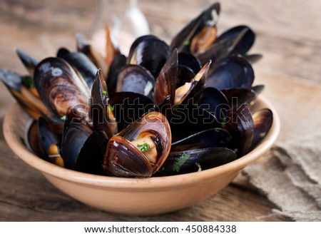 Boiled mussels - stock photo