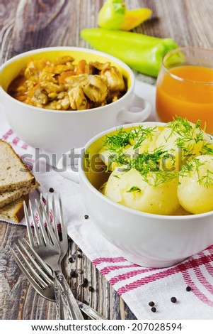 boiled new potatoes and fish stew in bowls on the table.selective focus - stock photo