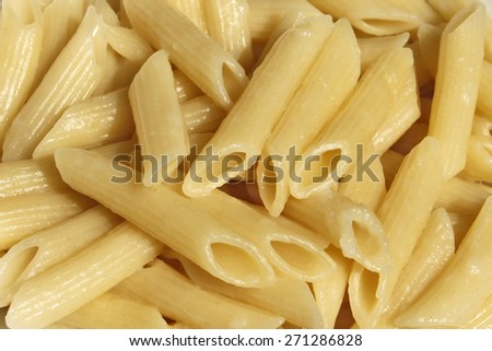Boiled plain pasta close up as a ingredient before preparing various dishes - stock photo