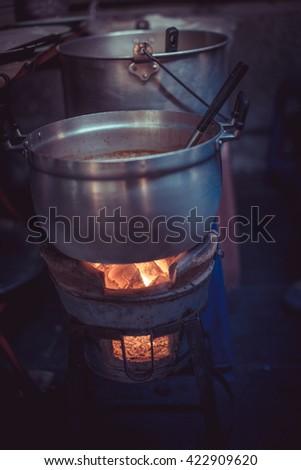 boiled pot on stove - stock photo