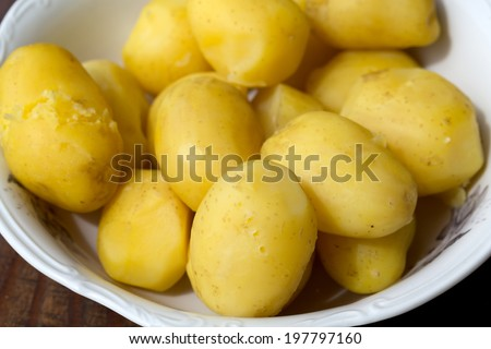 boiled potato in bowl - stock photo