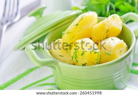 boiled potato in green bowl - stock photo