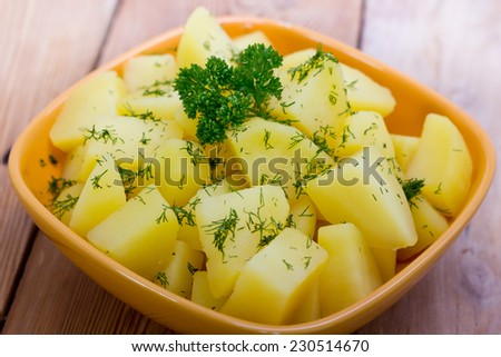 Boiled potatoes with fresh parsley and dill