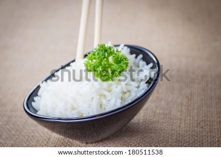 boiled rice in black bowl - stock photo