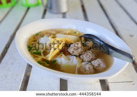 Boiled rice with pork and sliced omelette in white bowl - stock photo