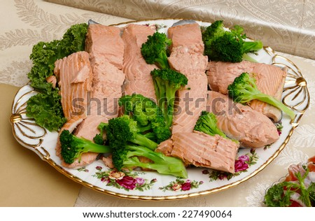 Boiled salmon with broccoli - stock photo