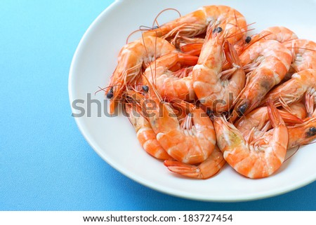 Boiled shrimp in a white plate - stock photo