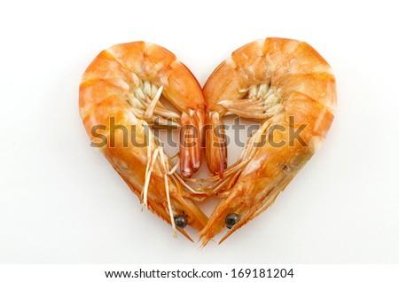 Boiled shrimp isolated on white with heart shape - stock photo