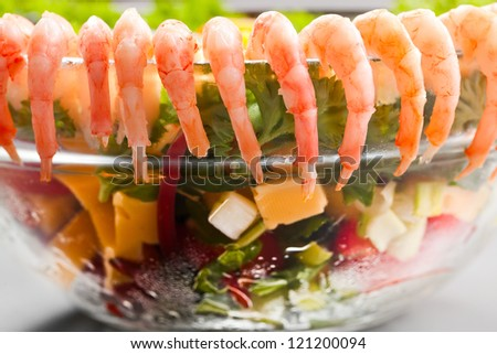 Boiled shrimp salad with cheese and vegetables.