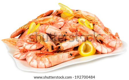 Boiled shrimp with lemon on a plate. Isolated on white background. - stock photo