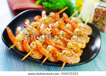 boiled shrimps are beaded on sticks