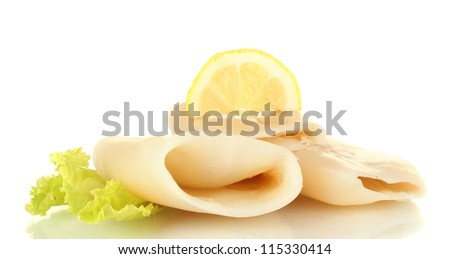 boiled squids with lettuce and lemon isolated on white