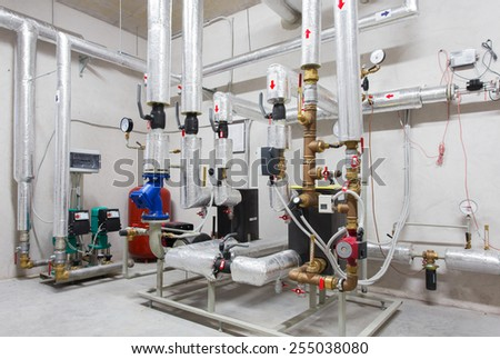 Boiler room in apartment building - stock photo
